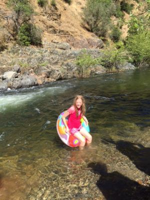 Swim and tubing in the river at Roaring Camp